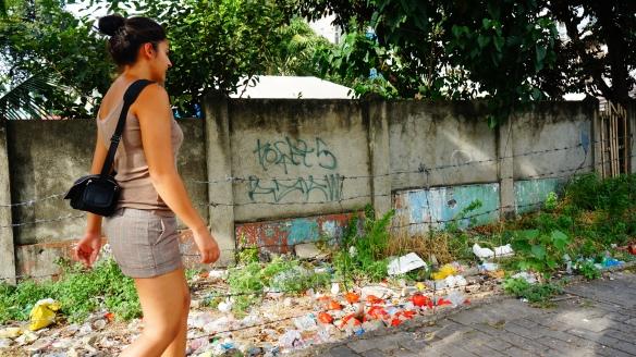 Rubbish, grafiti and barbed wire.